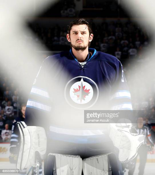 Goaltender Connor Hellebuyck of the Winnipeg Jets gets his game face on prior to puck drop against the Dallas Stars at the MTS Centre on February 14...