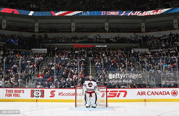 Goaltender Connor Hellebuyck of the Winnipeg Jets gets set in the goal prior to puck drop against the Calgary Flames at the MTS Centre on January 9...