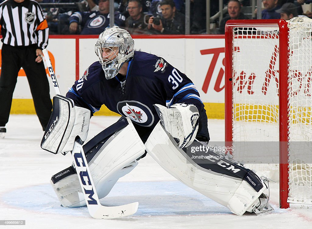 Goaltender <a gi-track='captionPersonalityLinkClicked' href=/galleries/search?phrase=Connor+Hellebuyck&family=editorial&specificpeople=10551764 ng-click='$event.stopPropagation()'>Connor Hellebuyck</a> #30 of the Winnipeg Jets guards the net during second period action against the Toronto Maple Leafs at the MTS Centre on December 2, 2015 in Winnipeg, Manitoba, Canada.