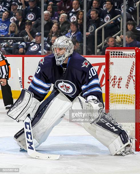 Goaltender Connor Hellebuyck of the Winnipeg Jets guards the net during second period action against the Toronto Maple Leafs at the MTS Centre on...