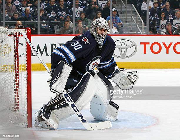 Goaltender Connor Hellebuyck of the Winnipeg Jets guards the net during first period action against the Columbus Blue Jackets at the MTS Centre on...