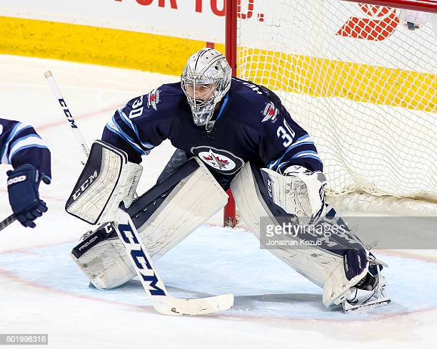Goaltender Connor Hellebuyck of the Winnipeg Jets guards the net during third period action against the St Louis Blues at the MTS Centre on December...