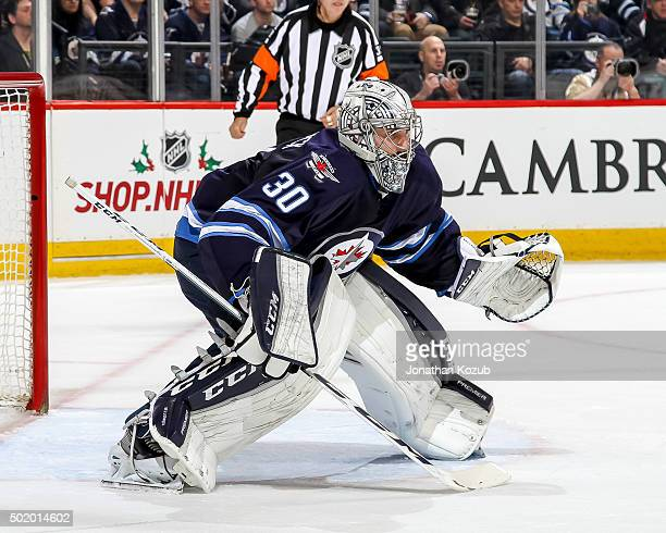 Goaltender Connor Hellebuyck of the Winnipeg Jets guards the net during first period action against the St Louis Blues at the MTS Centre on December...