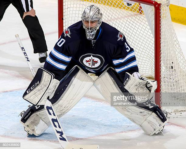Goaltender Connor Hellebuyck of the Winnipeg Jets guards the net during third period action against the New York Rangers at the MTS Centre on...