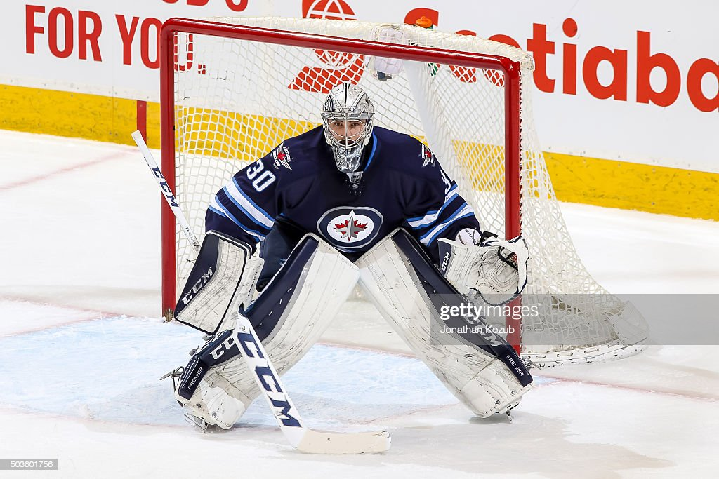 Goaltender <a gi-track='captionPersonalityLinkClicked' href=/galleries/search?phrase=Connor+Hellebuyck&family=editorial&specificpeople=10551764 ng-click='$event.stopPropagation()'>Connor Hellebuyck</a> #30 of the Winnipeg Jets guards the net during first period action against the Detroit Red Wings at the MTS Centre on December 29, 2015 in Winnipeg, Manitoba, Canada. The Jets defeated the Wings 4-1.