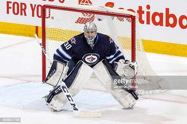Goaltender Connor Hellebuyck of the Winnipeg Jets guards the net during first period action against the Detroit Red Wings at the MTS Centre on...
