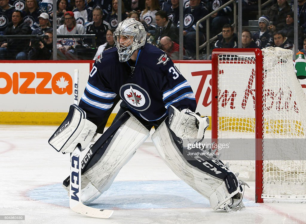 Goaltender <a gi-track='captionPersonalityLinkClicked' href=/galleries/search?phrase=Connor+Hellebuyck&family=editorial&specificpeople=10551764 ng-click='$event.stopPropagation()'>Connor Hellebuyck</a> #30 of the Winnipeg Jets guards the net during second period action against the Buffalo Sabres at the MTS Centre on January 10, 2016 in Winnipeg, Manitoba, Canada.