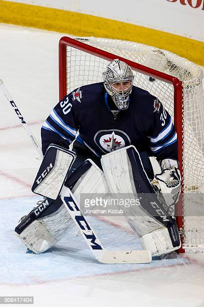 Goaltender Connor Hellebuyck of the Winnipeg Jets guards the net during second period action against the Colorado Avalanche at the MTS Centre on...
