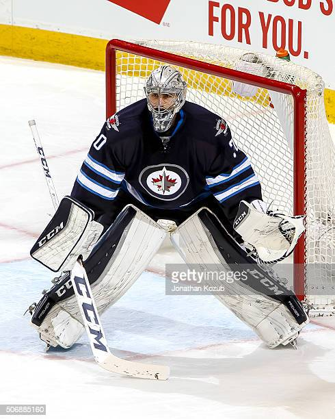 Goaltender Connor Hellebuyck of the Winnipeg Jets guards the net during third period action against the Nashville Predators at the MTS Centre on...