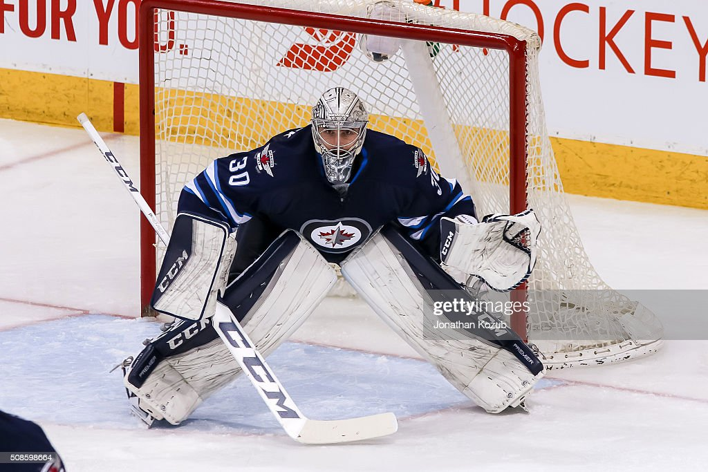 Goaltender <a gi-track='captionPersonalityLinkClicked' href=/galleries/search?phrase=Connor+Hellebuyck&family=editorial&specificpeople=10551764 ng-click='$event.stopPropagation()'>Connor Hellebuyck</a> #30 of the Winnipeg Jets guards the net during third period action against the Dallas Stars at the MTS Centre on February 2, 2016 in Winnipeg, Manitoba, Canada. The Stars defeated the Jets 5-3.
