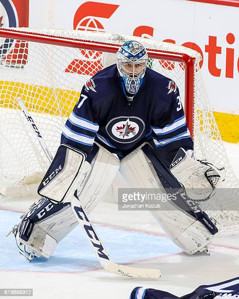 Goaltender Connor Hellebuyck of the Winnipeg Jets guards the net during third period action against the Dallas Stars at the MTS Centre on October 27...