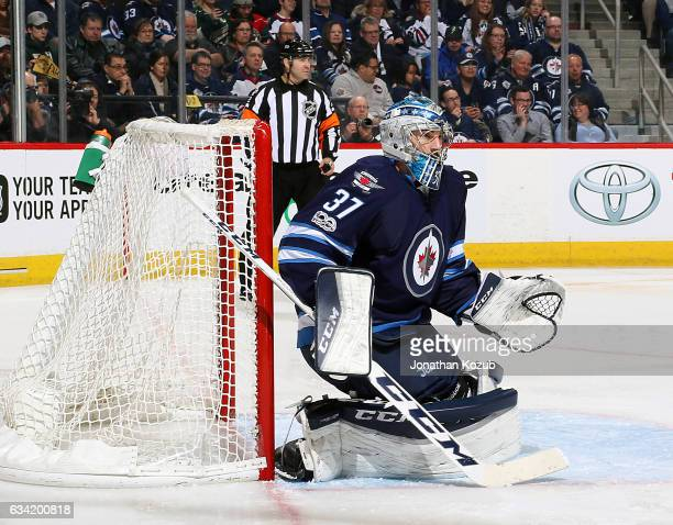 Goaltender Connor Hellebuyck of the Winnipeg Jets guards the net during third period action against the Minnesota Wild at the MTS Centre on February...