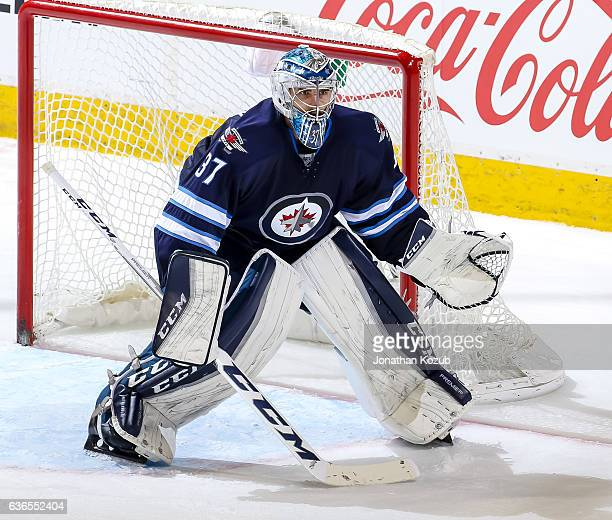 Goaltender Connor Hellebuyck of the Winnipeg Jets guards the net during third period action against the Colorado Avalanche at the MTS Centre on...