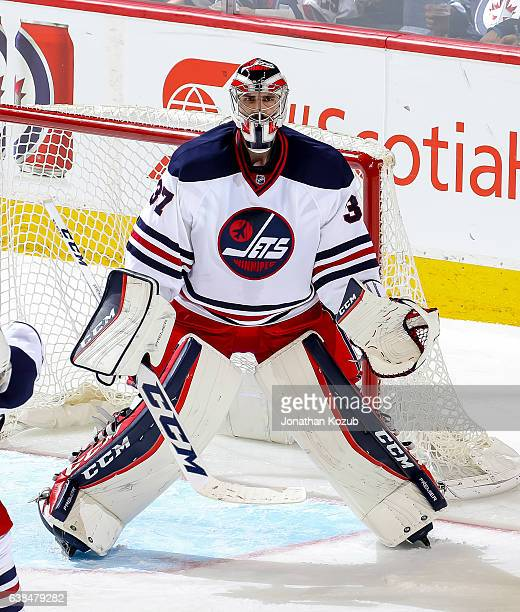 Goaltender Connor Hellebuyck of the Winnipeg Jets guards the net during third period action against the Calgary Flames at the MTS Centre on January 9...