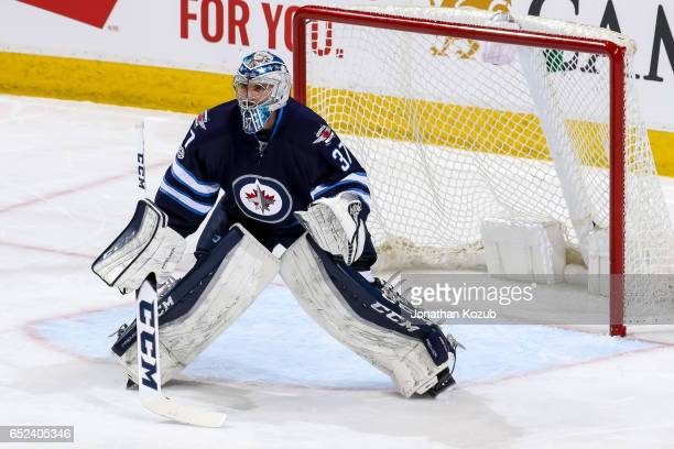 Goaltender Connor Hellebuyck of the Winnipeg Jets guards the net during first period action against the Pittsburgh Penguins at the MTS Centre on...