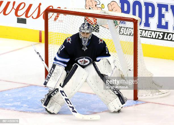 Goaltender Connor Hellebuyck of the Winnipeg Jets guards the net during third period action against the Carolina Hurricanes at the Bell MTS Place on...