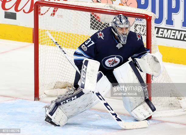 Goaltender Connor Hellebuyck of the Winnipeg Jets guards the net during third period action against the Philadelphia Flyers at the Bell MTS Place on...