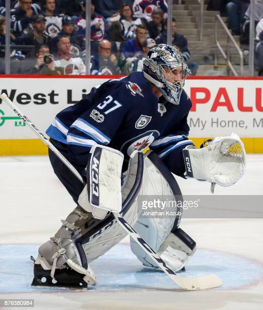 Goaltender Connor Hellebuyck of the Winnipeg Jets guards the net during first period action against the Arizona Coyotes at the Bell MTS Place on...