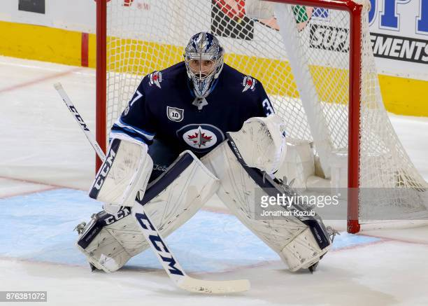 Goaltender Connor Hellebuyck of the Winnipeg Jets guards the net during third period action against the Arizona Coyotes at the Bell MTS Place on...
