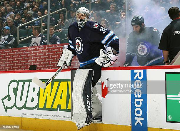 Goaltender Connor Hellebuyck of the Winnipeg Jets hits the ice prior to puck drop against the Dallas Stars at the MTS Centre on February 2 2016 in...
