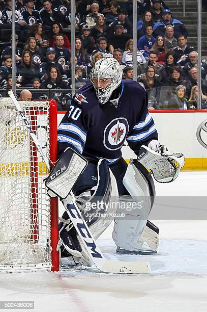 Goaltender Connor Hellebuyck of the Winnipeg Jets keeps an eye on the play behind the net during first period action against the New York Rangers at...