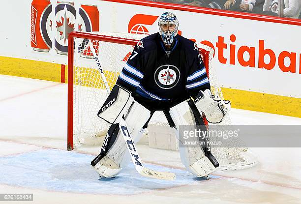Goaltender Connor Hellebuyck of the Winnipeg Jets keeps an eye on the play during third period action against the Nashville Predators at the MTS...