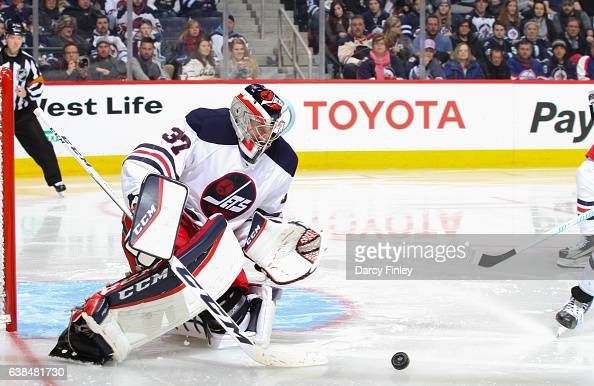 Goaltender Connor Hellebuyck of the Winnipeg Jets keeps an eye on the loose puck during third period action against the Calgary Flames at the MTS...