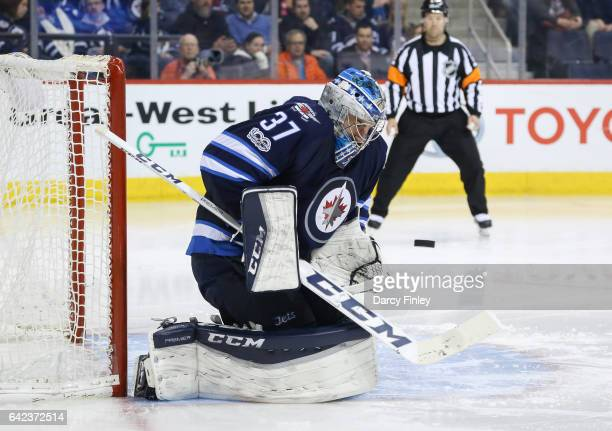 Goaltender Connor Hellebuyck of the Winnipeg Jets keeps an eye on the puck during third period action against the Dallas Stars at the MTS Centre on...