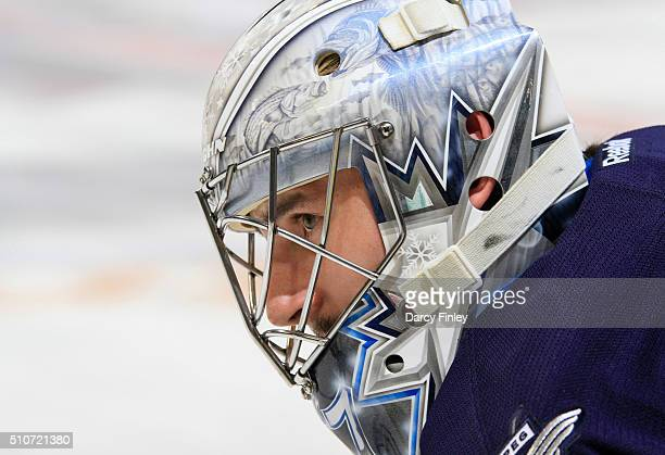 Goaltender Connor Hellebuyck of the Winnipeg Jets looks on during the pregame warm up prior to puck drop against the Boston Bruins at the MTS Centre...