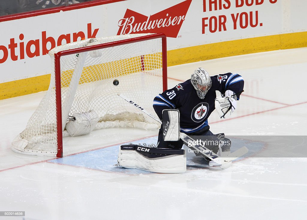 Goaltender <a gi-track='captionPersonalityLinkClicked' href=/galleries/search?phrase=Connor+Hellebuyck&family=editorial&specificpeople=10551764 ng-click='$event.stopPropagation()'>Connor Hellebuyck</a> #30 of the Winnipeg Jets reacts as the puck flies into the net for a second period goal by the St. Louis Blues at the MTS Centre on December 15, 2015 in Winnipeg, Manitoba, Canada. The Blues defeated the Jets 4-3.