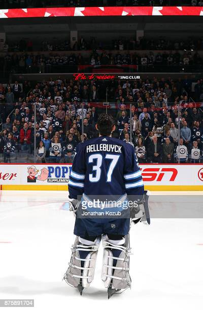 Goaltender Connor Hellebuyck of the Winnipeg Jets stands on the ice during the singing of 'O Canada' prior to puck drop against the New Jersey Devils...