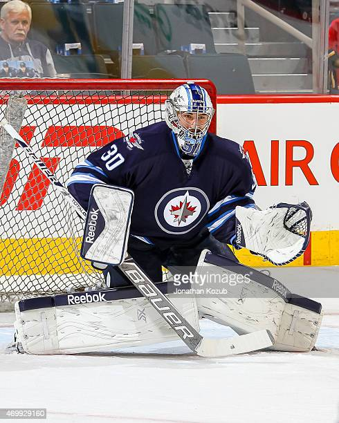 Goaltender Connor Hellebuyck of the Winnipeg Jets takes part in the pregame warm up prior to NHL action against the Calgary Flames on April 11 2015...