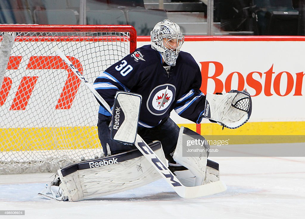 Goaltender <a gi-track='captionPersonalityLinkClicked' href=/galleries/search?phrase=Connor+Hellebuyck&family=editorial&specificpeople=10551764 ng-click='$event.stopPropagation()'>Connor Hellebuyck</a> #30 of the Winnipeg Jets takes part in the pre-game warm up prior to NHL action against the Colorado Avalanche at the MTS Centre on November 23, 2015 in Winnipeg, Manitoba, Canada.