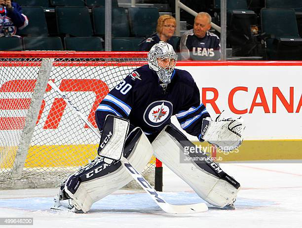 Goaltender Connor Hellebuyck of the Winnipeg Jets takes part in the pregame warm up prior to NHL against the Toronto Maple Leafs at the MTS Centre on...