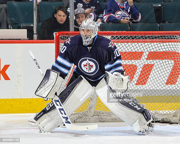 Goaltender Connor Hellebuyck of the Winnipeg Jets takes part in the pregame warm up prior to NHL action against the Toronto Maple Leafs at the MTS...