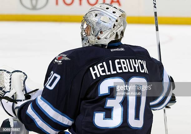 Goaltender Connor Hellebuyck of the Winnipeg Jets takes part in the pregame warm up prior to NHL action against the Arizona Coyotes at the MTS Centre...
