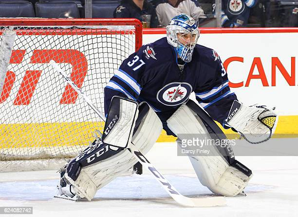 Goaltender Connor Hellebuyck of the Winnipeg Jets takes part in the pregame warm up prior to NHL action against the Los Angeles Kings at the MTS...