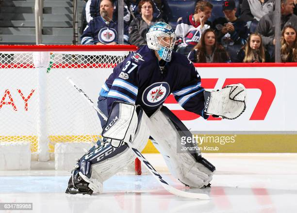Goaltender Connor Hellebuyck of the Winnipeg Jets warms up in the crease prior to puck drop against the Tampa Bay Lightning at the MTS Centre on...