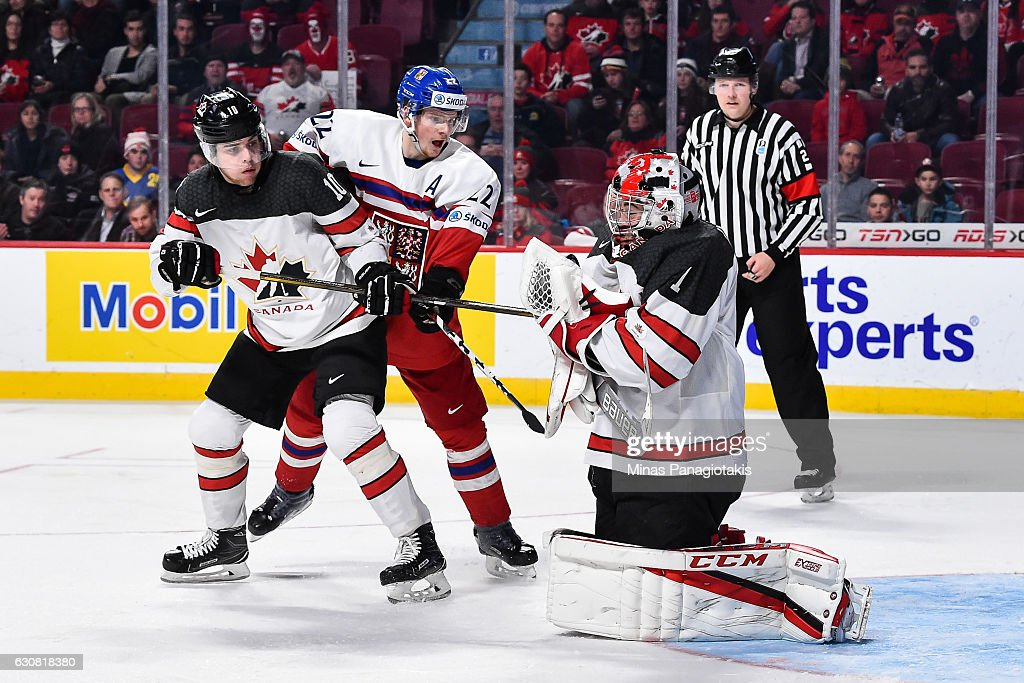 Goaltender Connor Ingram #1 of Team Canada makes a makes a save while teammate Kale Clague #10 and David Kase #22 of Team Czech Republic battle for position during the 2017 IIHF World Junior Championship quarterfinal game at the Bell Centre on January 2, 2017 in Montreal, Quebec, Canada. Team Canada defeated Team Czech Republic 5-3.