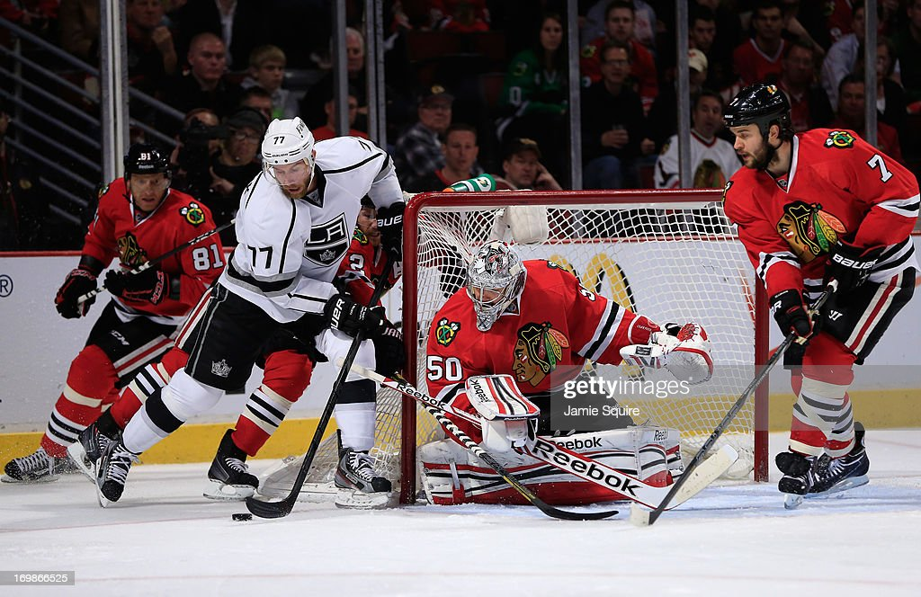 Goaltender <a gi-track='captionPersonalityLinkClicked' href=/galleries/search?phrase=Corey+Crawford&family=editorial&specificpeople=818935 ng-click='$event.stopPropagation()'>Corey Crawford</a> #50 and <a gi-track='captionPersonalityLinkClicked' href=/galleries/search?phrase=Brent+Seabrook&family=editorial&specificpeople=638862 ng-click='$event.stopPropagation()'>Brent Seabrook</a> #7 of the Chicago Blackhawks defend their net as <a gi-track='captionPersonalityLinkClicked' href=/galleries/search?phrase=Jeff+Carter&family=editorial&specificpeople=227320 ng-click='$event.stopPropagation()'>Jeff Carter</a> #77 of the Los Angeles Kings brings the puck around the net in the second period of Game Two of the Western Conference Final during the 2013 NHL Stanley Cup Playoffs at United Center on June 2, 2013 in Chicago, Illinois. The Blackhawks defeated the Kings 4-2.