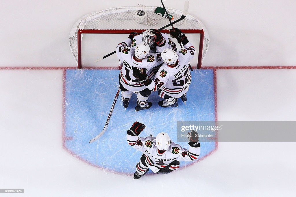 Goaltender <a gi-track='captionPersonalityLinkClicked' href=/galleries/search?phrase=Corey+Crawford&family=editorial&specificpeople=818935 ng-click='$event.stopPropagation()'>Corey Crawford</a> #50 of the Chicago Blackhawks celebrates with teammates their shoot out win against the Florida Panthers at the BB&T Center on October 22, 2013 in Sunrise, Florida.
