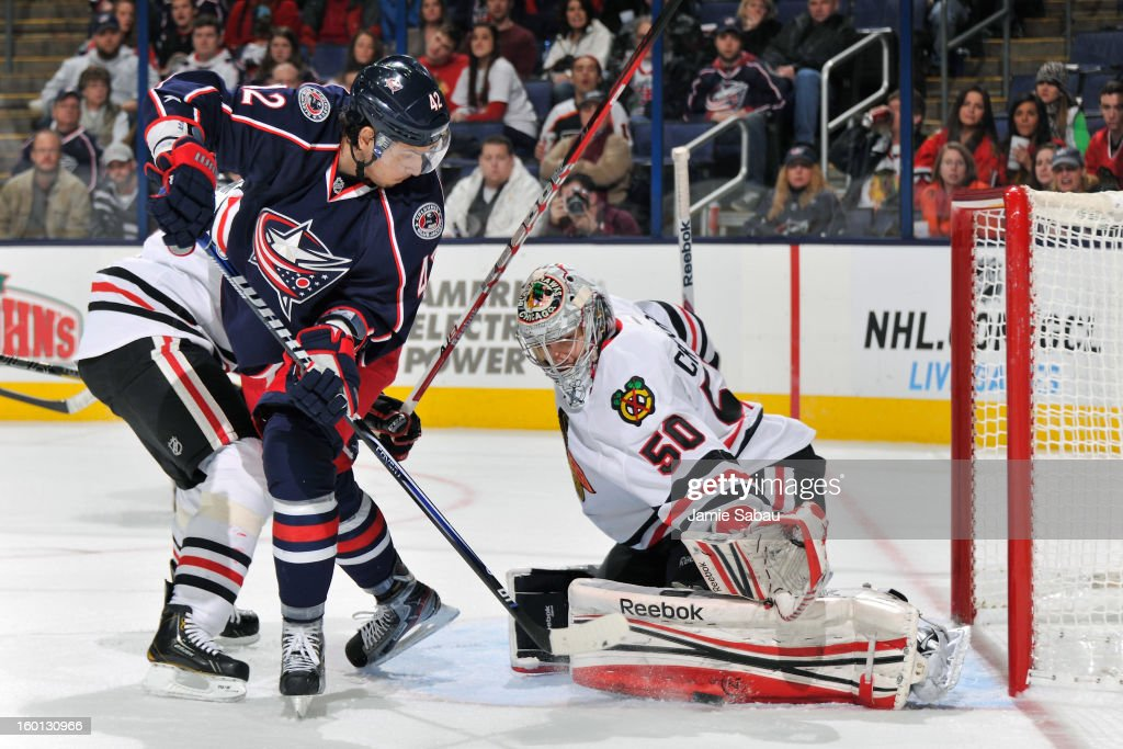 Goaltender Corey Crawford #50 of the Chicago Blackhawks makes a pad save on a shot from Artem Anisimov #42 of the Columbus Blue Jackets in the third period on January 26, 2013 at Nationwide Arena in Columbus, Ohio. Chicago defeated Columbus 3-2 to start the season 5-0 for the first time in team history.