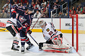 Goaltender Corey Crawford of the Chicago Blackhawks makes a pad save on a shot from Artem Anisimov of the Columbus Blue Jackets in the third period...