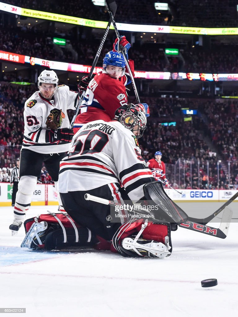 Goaltender Corey Crawford #50 of the Chicago Blackhawks makes a save while teammate Brian Campbell #51 battles for position with Artturi Lehkonen #62 of the Montreal Canadiens during the NHL game at the Bell Centre on March 14, 2017 in Montreal, Quebec, Canada. The Chicago Blackhawks defeated the Montreal Canadiens 4-2.