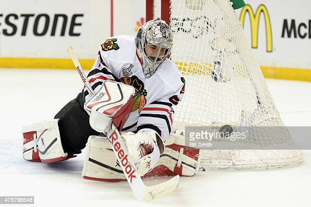Goaltender Corey Crawford of the Chicago Blackhawks makes a save against the Tampa Bay Lightning during the third period of Game One of the 2015 NHL...