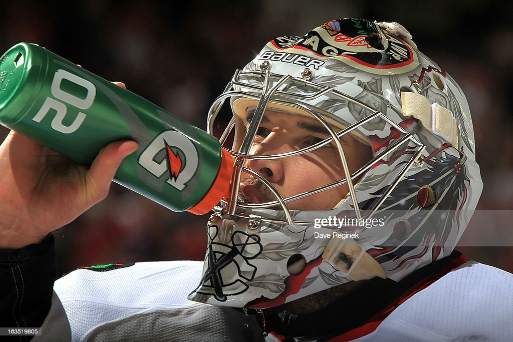 Goaltender Corey Crawford #50 of the Chicago Blackhawks pauses for a quick drink of water during an NHL game against the Detroit Red Wings at Joe Louis Arena on March 3, 2013 in Detroit, Michigan. Chicago won 2-1 in a shoot-out