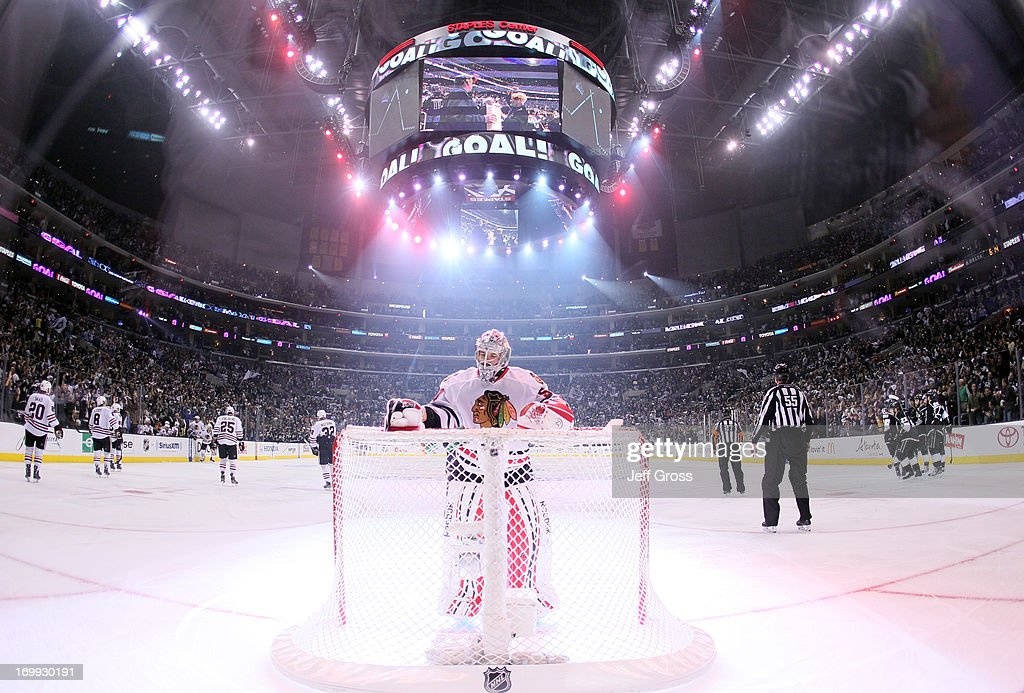 Goaltender <a gi-track='captionPersonalityLinkClicked' href=/galleries/search?phrase=Corey+Crawford&family=editorial&specificpeople=818935 ng-click='$event.stopPropagation()'>Corey Crawford</a> #50 of the Chicago Blackhawks reaches for the water bottle after giving up a goal to Justin Williams #14 of the Los Angeles Kings in the first period of Game Three of the Western Conference Final during the 2013 NHL Stanley Cup Playoffs at Staples Center on June 4, 2013 in Los Angeles, California. The Kings defeated the Blackhawks 3-1.