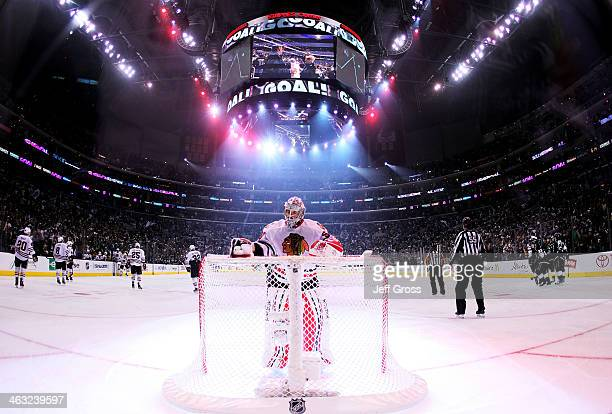 Goaltender Corey Crawford of the Chicago Blackhawks reaches for the water bottle after giving up a goal to Justin Williams of the Los Angeles Kings...