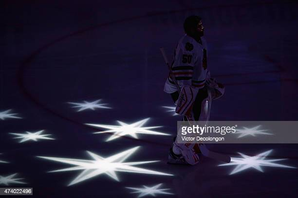 Goaltender Corey Crawford of the Chicago Blackhawks stands on the ice during the singing of the national anthem before playing the Anaheim Ducks in...