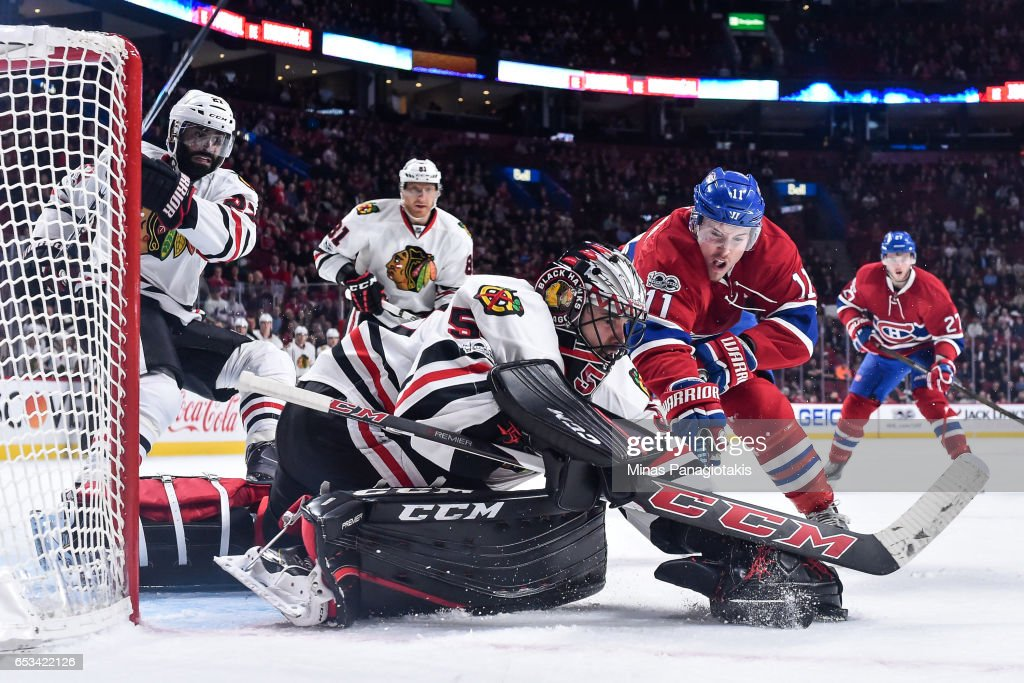 Goaltender Corey Crawford #50 of the Chicago Blackhawks tries to cover the puck near Brendan Gallagher #11 of the Montreal Canadiens during the NHL game at the Bell Centre on March 14, 2017 in Montreal, Quebec, Canada. The Chicago Blackhawks defeated the Montreal Canadiens 4-2.